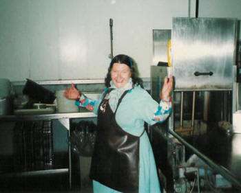 Rosemary Johnson church member and longtime volunteer joyfully washes dishes during lunchtime.