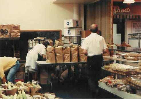 Duane and Rosemary prepare to distribute Pastor Paul's Mission Grocery Shelf orders in 1986.