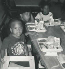 Small children enjoy lunch at Pastor Paul's Mission Hot Meals Program.