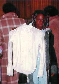 A young girl finds a blouse at the Clothing Closet.