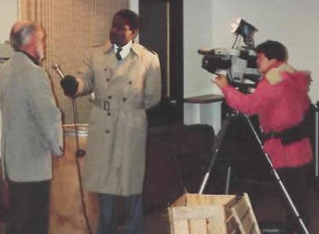 Pastor Paul S Arnopoulos is interviewed by the TV station about the Thanksgiving GiveAway in 1985.